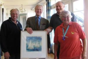 The winners are presented with the Bembridge Canvas by Philip Bown, Commodore of the Bembridge Sailing Club Photograph by Clare Blevins.