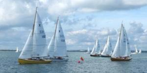 Team captains Herring (152) and Priscott (132) in close combat at the start of the final race. Photograph - Guy Partington